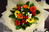 A fresh Mixed Bouquet of White, Orange and Yellow.  Includes spring flowers for a mild scent.