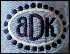"Sample of the 2x3 size frame stitched on a hat with ""ADK"" from our #1382 Reese Font and Monogram [sold separately] - without applique fabric - super easy!"