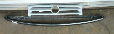 Primered grill & metal filler strip.