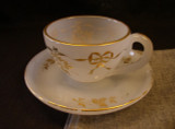 Opaline Glass Gilt Decorated Cup and Saucer