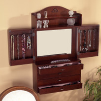Center portion of this armoire open to reveal a large mirror back with 4 double hooks and a secure shelf on each side