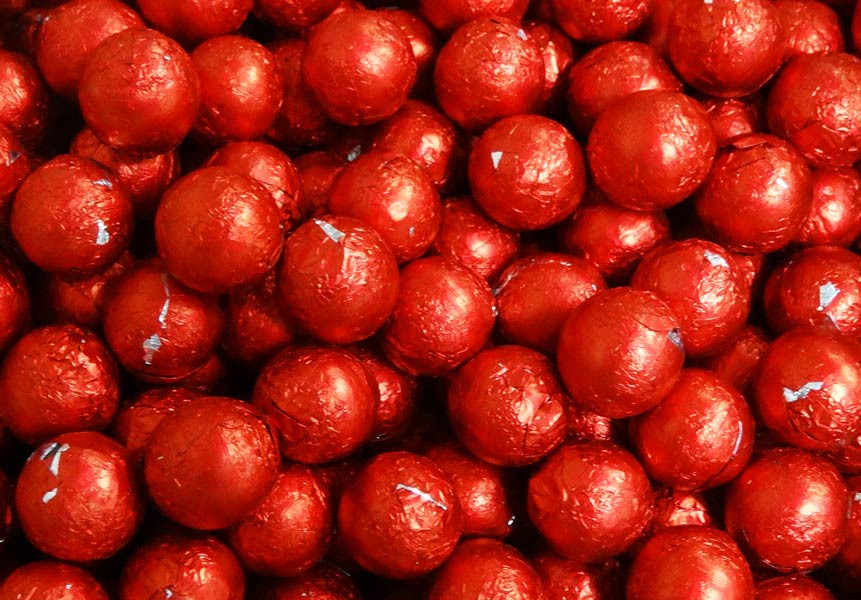 Foiled Milk Choc Red Balls, by Confectionery Trading Company/Niagara,  and more Confectionery at The Professors Online Lolly Shop. (Image Number :5026)