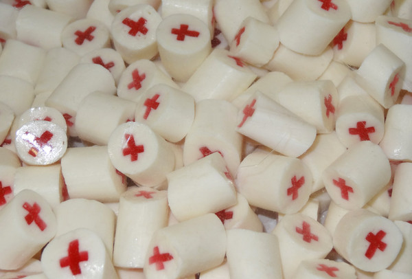 Pink and White Crosses Rock Candy, by Designer Candy,  and more Confectionery at The Professors Online Lolly Shop. (Image Number :5216)