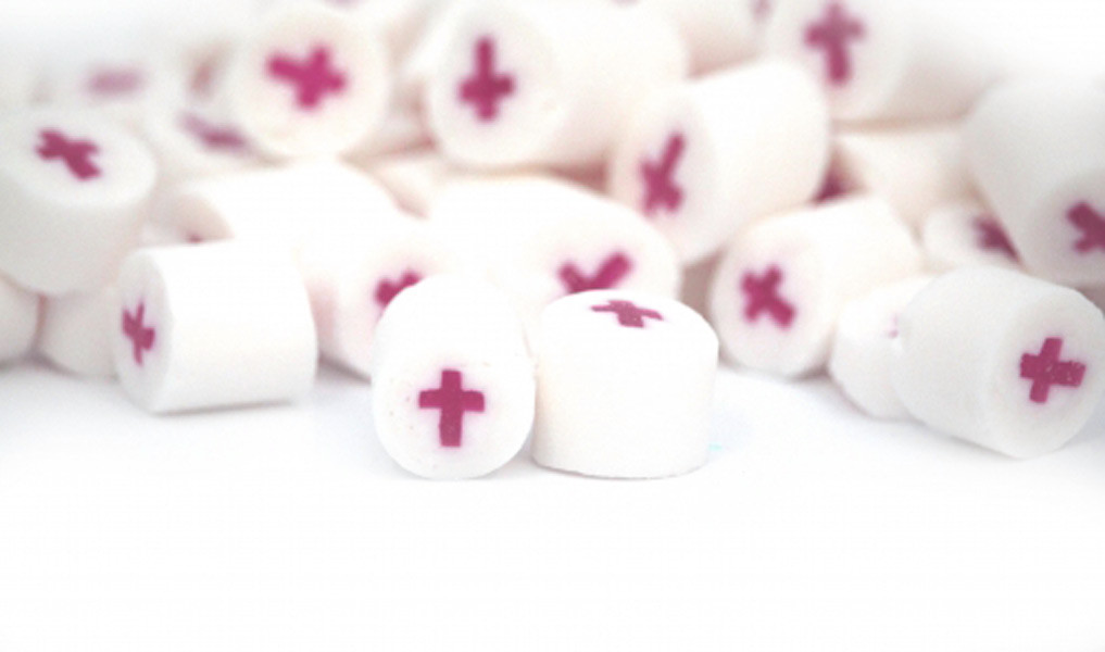 Rock Candy - White and Pink - Cross Center, by Designer Candy,  and more Confectionery at The Professors Online Lolly Shop. (Image Number :9097)