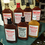 "Blazin Rectums Heat added to our Original, Peach, Wing Sauce, Mustard, Raspberry, Ketchup, and one with a little Moonshine added.  This is the stuff for the person who loves it to ""Bite Back"".  These are the Bootlegger Flask, Pint size bottles."