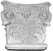 Ornate acanthus leaves and turning top corner volutes are featured on this angular cast gypsum capital.  Roman Corinthian