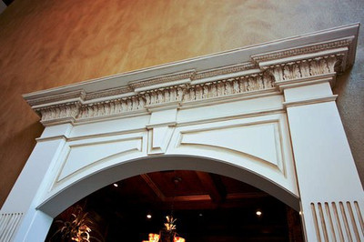 DM712 Crown Molding used above the arched doorway