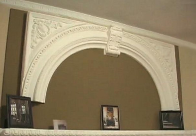 A plaster arched overmantel featuring Acanthus Leaves and Egg and Dart molding