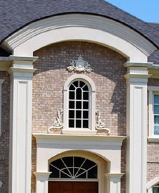 A pair of CRA28 Right and left scrolling acanthus leaf appliques combined in this image with CRA30-L and CRA30-R accent the bottom of a residential window exterior with CRA17 installed above