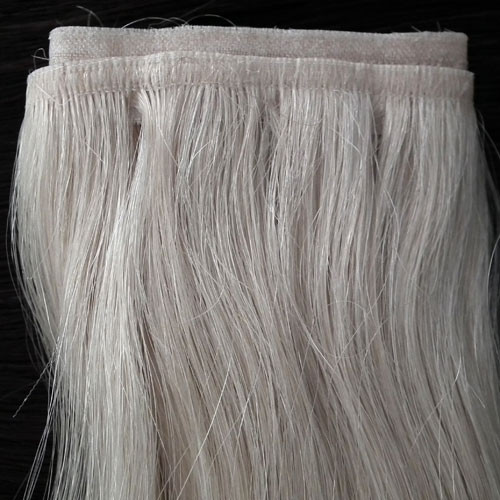 Flat weft hair extensions