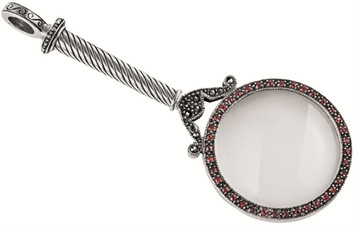 Antique finished marcasite and garnet set magnifying glass pendant. Magnification x 6