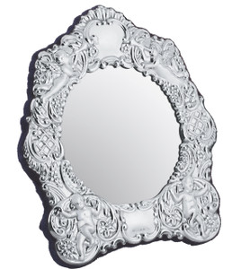 Embossed Victorian table mirror with velvet back