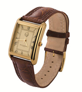 Men's Vermeil watch;curved champagne dial;brown leather strap with vermeil buckle;swiss movement;water resistant case;sapphire set winder