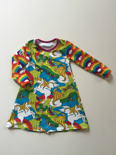 Ruby Dress in Unicorns with rainbow sleeves.