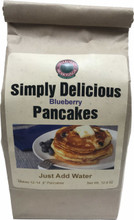 "Our Simply Delicious Blueberry Pancakes are sure to impress. Our mix is carefully handcrafted with real dried Blueberries. They are so simple all you need to add is water. Pair the mix with any of our homemade syrups for a breakfast twist. This mix yields 12-14 4"" Pancakes."