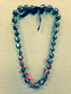 Tiger Kukui Nut leis with red ribbon