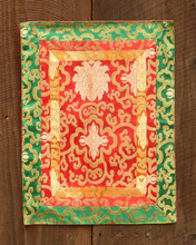 Small red table brocade with orange, red and green border (12x16 inches)
