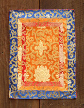Small orange table brocade with red, orange and blue border (12x16 inches)