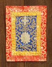 Small blue table brocade with yellow and red border (12x16 inches)