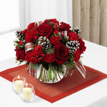 The FTD® Christmas Peace™ Bouquet brings beauty and grace to their home or holiday table with each elegant bloom. Rich red roses are a standout arranged amongst red carnations and mini carnations, red hypericum berries and an assortment of lush holiday greens. Accented with white pinecone pics and a red, white and green plaid designer ribbon, this fresh flower bouquet is presented in a clear glass bubble bowl vase to create a wonderful Christmas gift for any of the special people in your life.