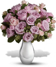 Lavender roses have never been more spectacularly presented than in this dazzling Silver Reflections vase. Certain to be an instant favorite, this lovely vase will remind her of you every time she uses it, which will be often. Vase may vary but will be High End Vase.