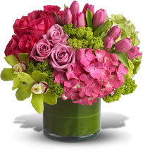 Upscale and uptown. This fantastic arrangement is a beauty and a half to behold. Overflowing with gorgeous blossoms and delivered in a leaf-lined cylinder vase, it's truly a floral fantasy.