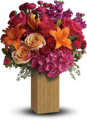 Fabulous! Hot pink flowers are mixed with sunny orange blooms to warm her heart and tickle her fancy. Perfect for birthdays -or any day you want to make her feel extra special.