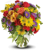 If you close your eyes and make a wish, perhaps someone will send you this deluxe version of our Make a Wish bouquet, with a big, bright bunch of fresh flowers in cheerful shades of yellow, purple, orange and red. A scrumptiously pretty gift for any day of the year.