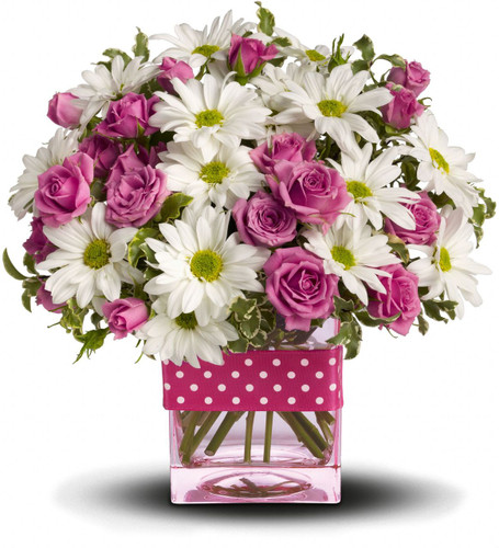 Polka dots and posies, they're the perfect pair. Well, at least in this pretty arrangement they are. Just the right flowers in just the right vase all wrapped up in, you guessed it, just the right ribbon.