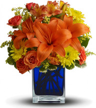 Hot summer flowers in a  contemporary cube vase.