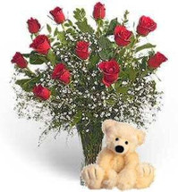 A Dozen Long Stem Beauties arranged with Million Star Baby's Breath and a lovely Teddy Bear to accompany it, sends your message in style.