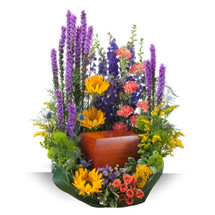 """These beautiful garden variety flowers surround the urn of your loved one.  Approximately 20"""" wide by 24"""" high"""