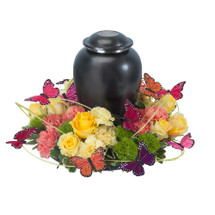 "Butterflies surround the urn of your loved one as a sign of hope and love. Approximately 16"" in diameter"