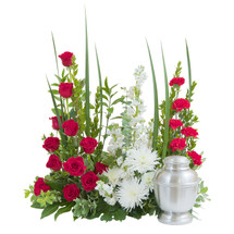 """This beautiful selection of red and white flowers and foliage create a stately backdrop for the urn.  Approximately 20"""" tall x 16"""" wide"""