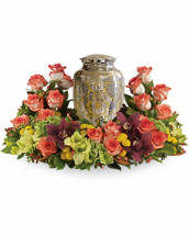 A rich and subtly hued garden expresses sympathy most thoughtfully, in a gentle oval arrangement that honors and embraces a cherished memory.