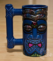 One of a kind green ceramic Tiki Mug 100% made in Hawaii hand painted by Shannon O'Connell. Features a special glow in the dark blacklight paint and is selected directly from Shannon's private collection.