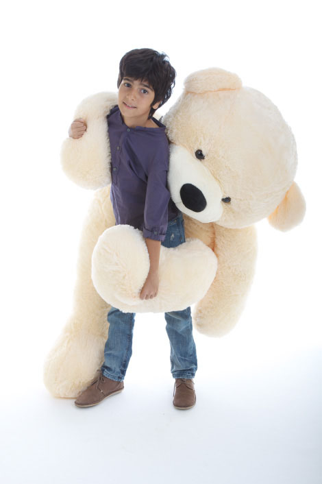 cozy-cuddles-soft-and-huggable-jumbo-cream-teddy-bear-60in.jpg