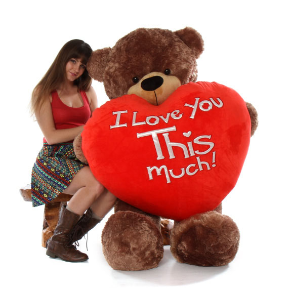 sunny-cuddles-with-world-s-largest-i-love-you-this-much-big-teddy-bear-heart-5-feet-tall-valentines-teddy-bear.jpg