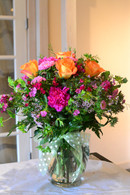 "Telefloras ""How sweet it is"" filled with vibrant pinks and oranges."