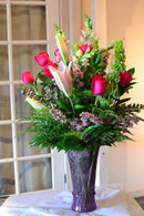 Hot Pink roses, Pink lilies, Bells of irealnd, White snapdragons in a purple vase