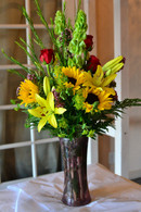 The sunny day bouquet is a perfectly cheerful bouquet made up of Bright yellow lilies and SUNflowers, red roses, and  beautiful tall and slender bells of Ireland. Perferct for Mothers Day, sending Birthday wishes or a Get Well.