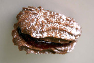 CHOCOLATE COOKIE SANDWICH:  Two chocolate butter wafers with a raspberry center. Price per 1 pound.