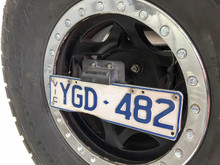 Number plate relocation bracket