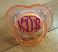 Orange binkie with magenta intertwined monogram