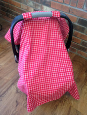 This car seat cover is red and white checkered on the front. The inside is lined with a soft, white minky fabric. Add a name or monogram for a personal touch! The personalization will be placed in the center of the cover.