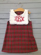 This green, red, and black plaid shift dress is a great Christmas addition. The colors set the Christmas mood perfectly. Has white top part to help with personalization. Monogrammed initials on white, to show up easy and make your personalization perfect.