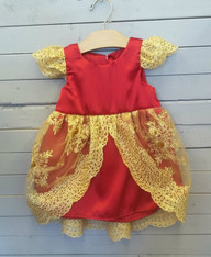 This gorgeous Virginia dress is perfect for making a little one feel like a princess. It has a very formal look to it and can be used for many different occasions. The dress is made out of red satin, and has some gold lace over top. Perfect for a little princess.