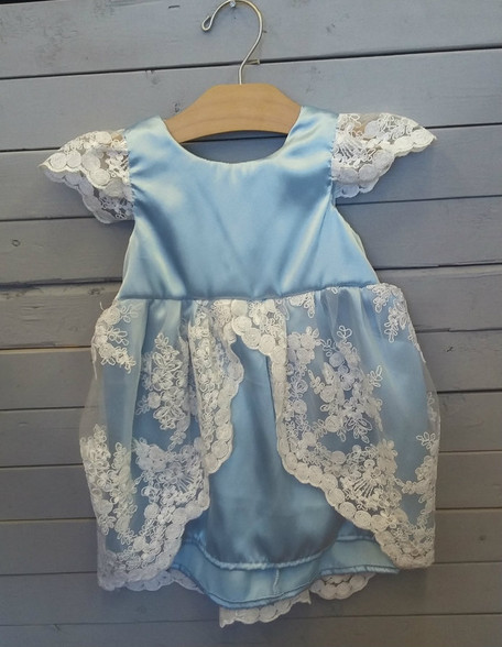This adorable Virginia dress is so adorable for all ages. It'll truly make your little one feel like a princess. This dress is made out of a light blue satin material, and has lace overtop. It is just too cute to pass up!
