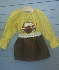 This applique turkey dress is perfect for fall and thanksgiving. It has long sleeves, which makes it perfect even when its a little chilly outside. The colors and style will have everybody in a fall mood.