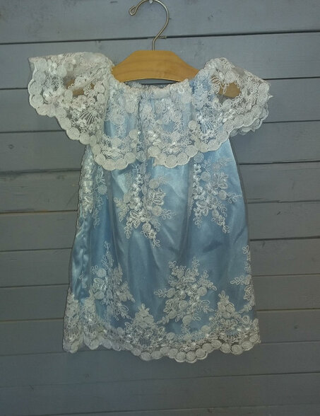 This blue satin gown is topped off with white lace. it can be worn as fancy or casual. It would be useful for many occasions.